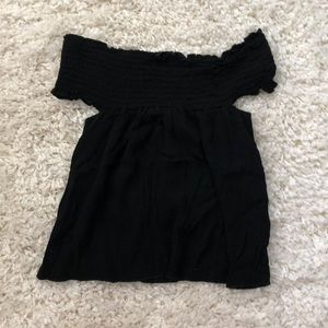 a black off the shoulder top